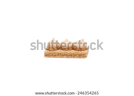 Peanut brittle with sesame and biscuits. Isolated on white.                                - stock photo