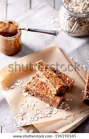 Peanut butter and oatmeal granola bars on a wooden background - stock photo