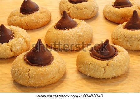 Peanut Butter Blossoms Cookies on a Wooden Cutting Board