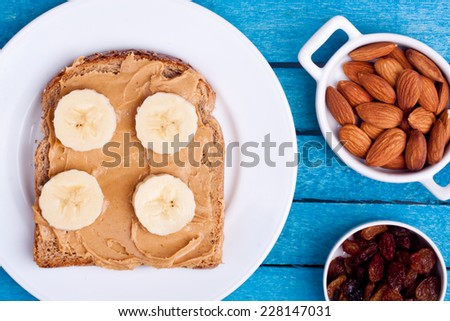 peanut butter bread with banana,almond,dried grape - stock photo