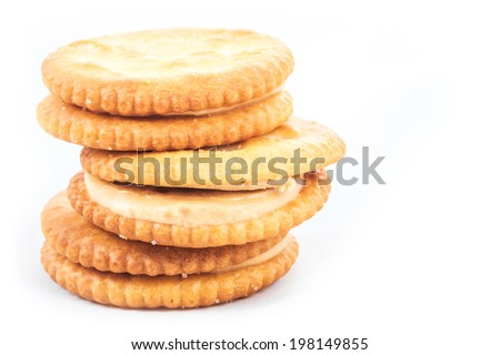 Peanut butter cream and biscuit in white background
