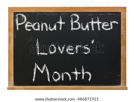 Peanut Butter Lovers/ Month written in white chalk on a black chalkboard isolated on white