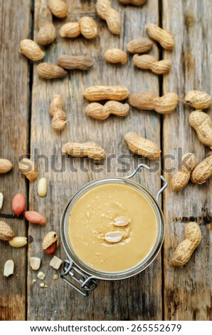 peanut butter on a dark wood background. tinting. selective focus - stock photo