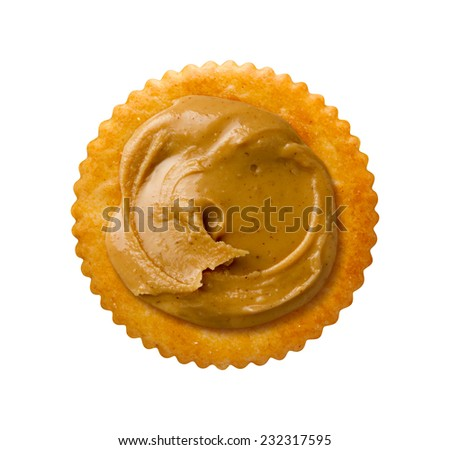 Peanut Butter on Round Cracker isolated on white  with a clipping path.   - stock photo