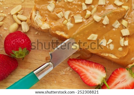 Peanut butter sandwich on a wood background - stock photo