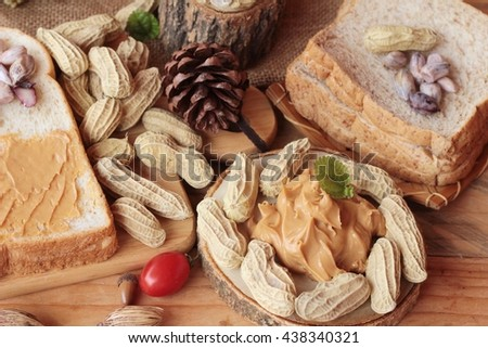 Peanut butter smeared on bread is delicious - stock photo