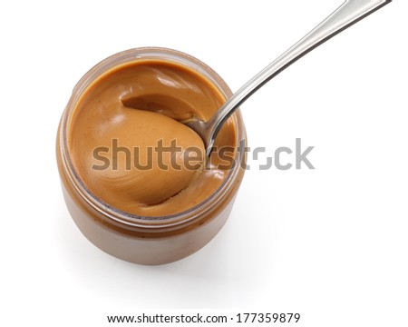 Peanut butter with spoon - stock photo