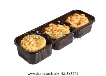 Peanut cookies in disposable plastic packing box. Isolated with clipping path.
