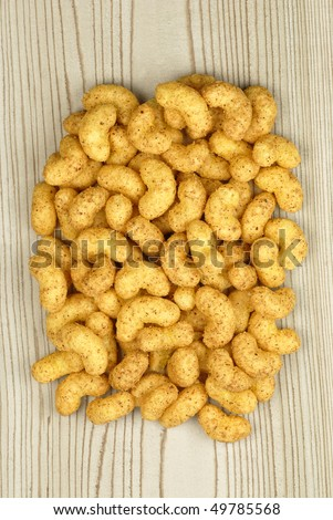 Peanut flips on wooden background from top - stock photo