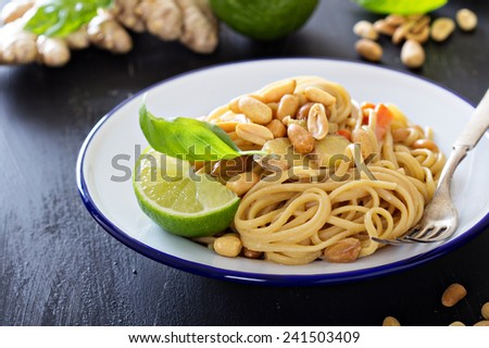 Peanut ginger one pan pasta with vegetables and lime - stock photo