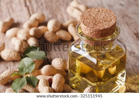 peanut oil in a glass jar on a table macro. horizontal