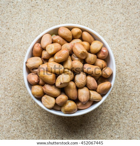 Peanut or groundnut, Colorful various beans or lentils and whole grains seeds or cereal in white cup on wood background. - stock photo