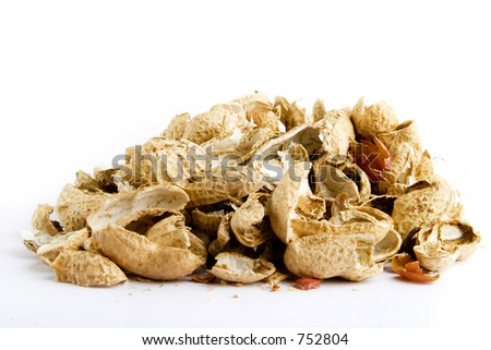 Peanut shells in a pile over white