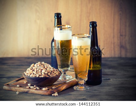 Peanuts and a Beer - stock photo
