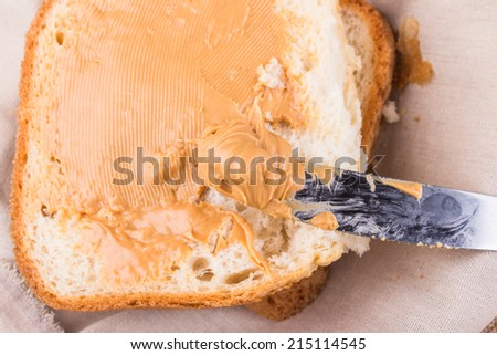 peanuts butter on the bread - stock photo