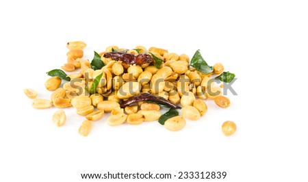 Peanuts. Close up of fried, peeled and salted peanuts on white background - stock photo