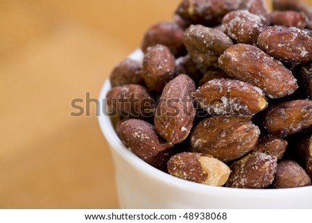 Peanuts in white bowl. Close-up. Shallow dof. Eos 1ds mkII - stock photo
