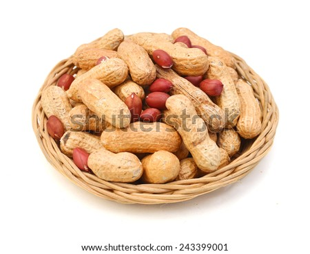 peanuts isolated in basket on white background  - stock photo