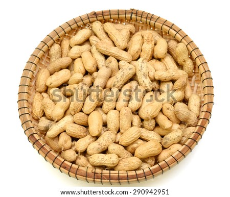 Peanuts on white ground - stock photo