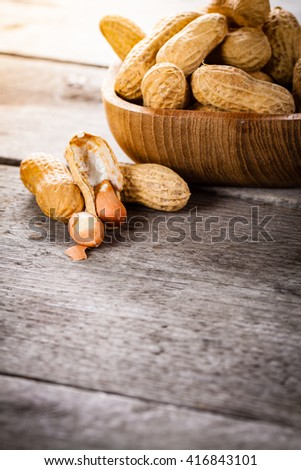 Peanuts on wooden bowls.