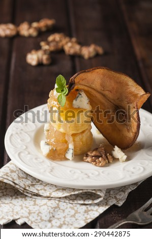 Pear and gorgonzola puff pastry dessert with walnuts - stock photo