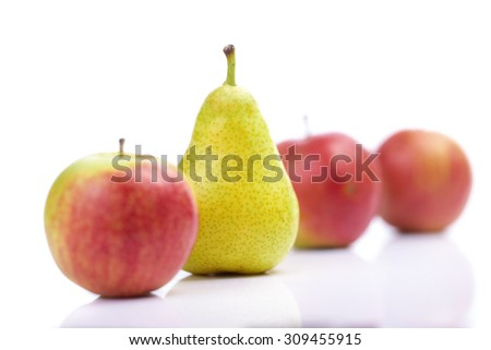 Pear and red apples isolated on white background
