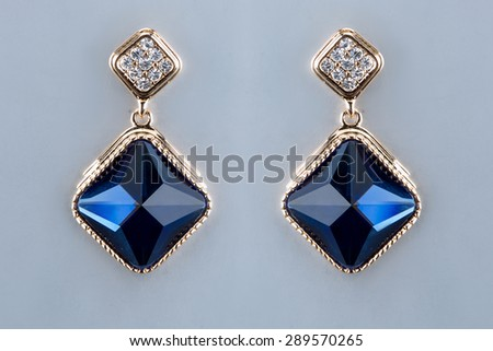 Pear Diamonds Earrings. blue gems - stock photo
