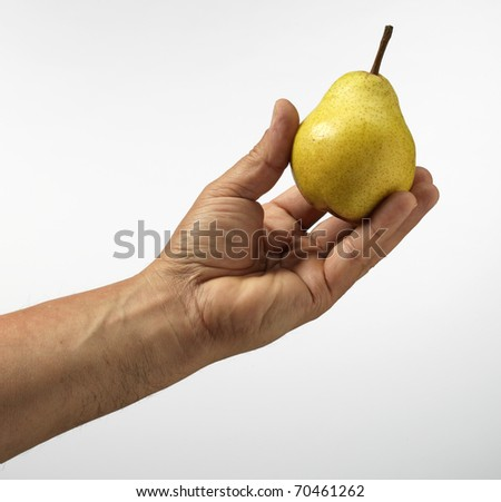 pear in hand - stock photo