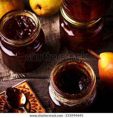 Pear jam on a wooden table. Style rustic. Selective focus.