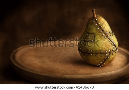 pear manipulated fruit with nails holding it together genetic manipulation gmo concept genetically altered food - stock photo