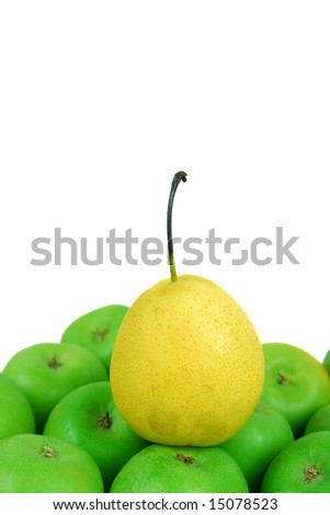 Pear on the top of apples in white background - stock photo