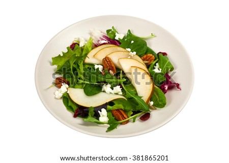 Pear Salad with Goat Cheese, Cranberry and Pecans. Isolated on white. Selective focus. - stock photo