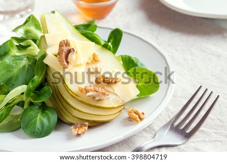 Pear salad with parmesan cheese and walnuts