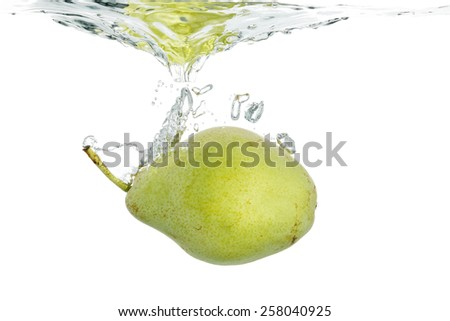 pear sinking into water on white - stock photo