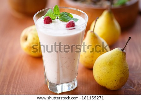 pear smoothie with berries and mint in a glass - stock photo