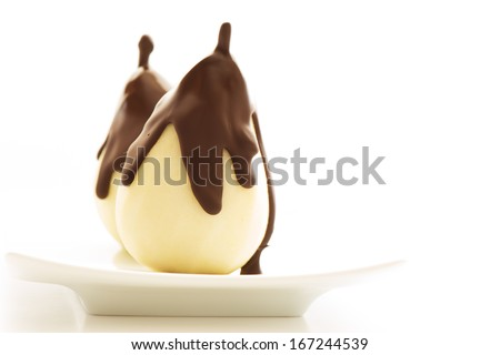 pear with chocolate isolated on white background - stock photo