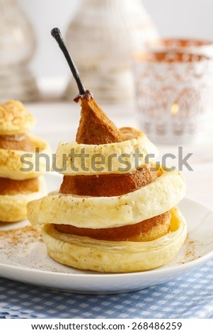 Pear with cinnamon in pastry - stock photo