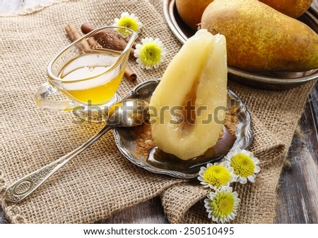 Pear with honey - stock photo