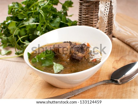 Pearl barley and beef with bone soup bowl - stock photo