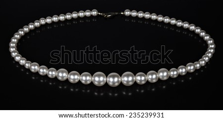 Pearl beads on a black background - stock photo