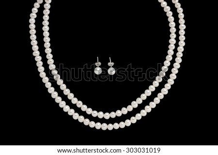 Pearl Earring and necklace isolated on black background - stock photo