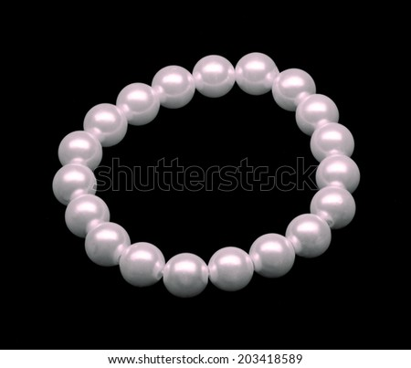 Pearl isolated over dark background - stock photo