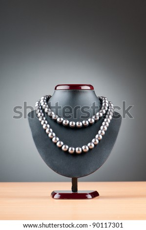 Pearl necklace against gradient background - stock photo