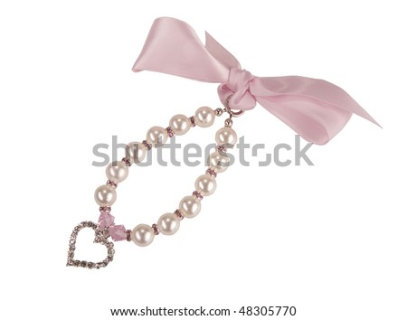 pearl necklace and brilliant heart - stock photo
