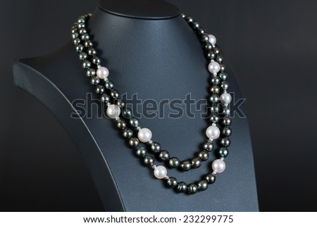 Pearl Necklace on black background - stock photo