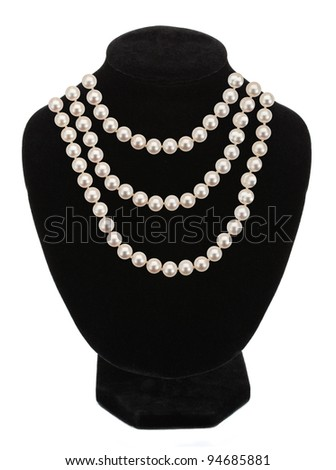 Pearl necklace on black mannequin isolated on white background - stock photo