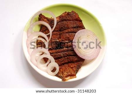 pearl spot fish fry with onion - stock photo