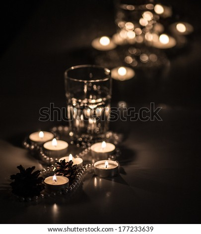 Pearls and a glass in the candlelight - stock photo