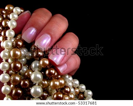 Pearls and Fingernails - stock photo