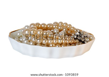 Pearls and Rhinestone in porcelain dish - isolated with clipping path.